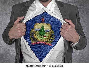 Business man show t-shirt flag of USA state Vermont rips open his shirt