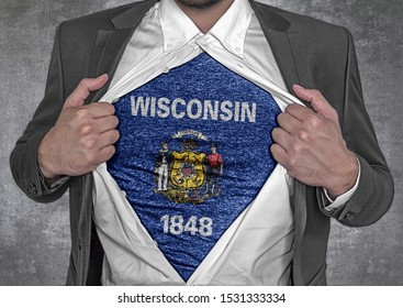 Business man show t-shirt flag of USA state Wisconsin rips open his shirt
