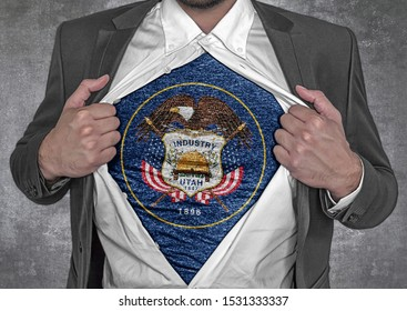 Business man show t-shirt flag of USA state Utah rips open his shirt