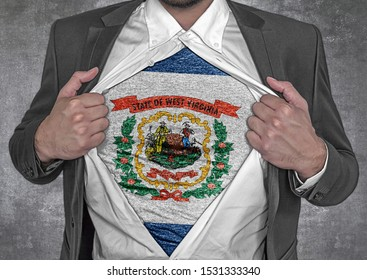 Business man show t-shirt flag of USA state West Virginia rips open his shirt