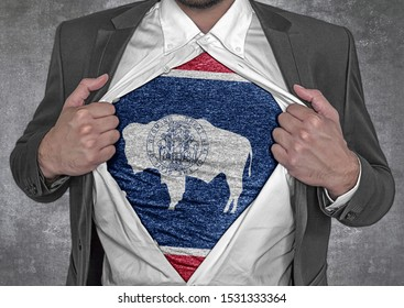 Business man show t-shirt flag of USA state Wyoming rips open his shirt