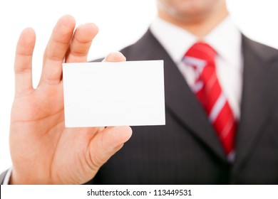 Business man showing a blank business card over white background
