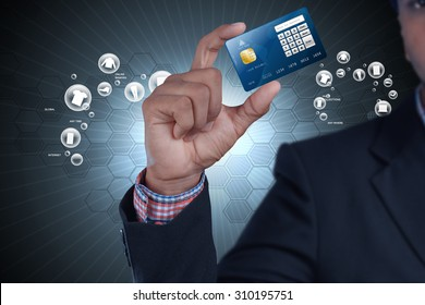 Business man showing credit card in color background