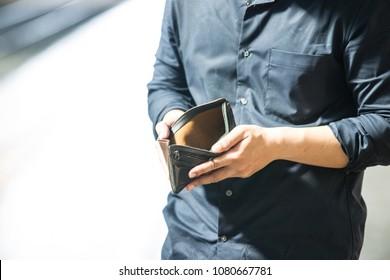 Business man showing empty wallet,salaryman lifestyle
