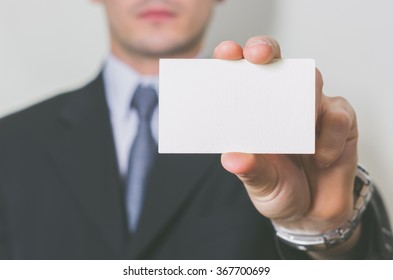 business man showing his business card on a white background - people, business and lifesyle concept