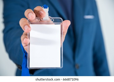business man showing identification card