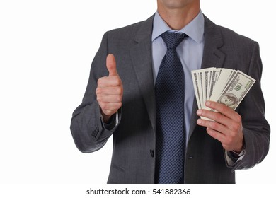Business Man showing money with thumb up isolated on white background. Success, investment, financial growth, profit, dividends concept