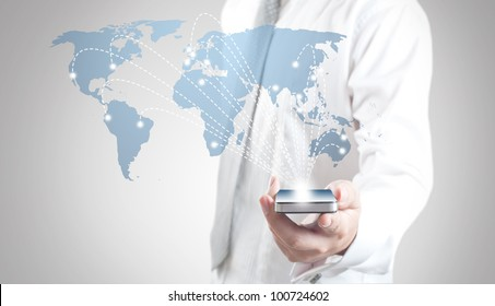 Business man showing smart phone with world map for social and internet connectivity concept