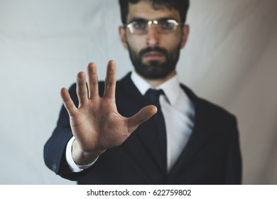 Business man showing stop hand gesture