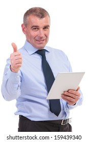business man showing the thumb up sign to the camera while holding his tablet. on a white background