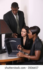 business man showing two women