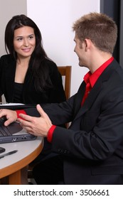 business man showing working woman