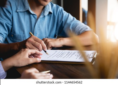 Business man signing a contract. Close up of two business partners signing a document for agreement contract - business etiquette, congratulation, merger and acquisition concept