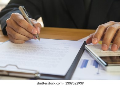Business man signing a contract. Owns the business sign personally,director of the company, solicitor. Real estate agent holding house, moving home or renting property, merger and acquisition concept.