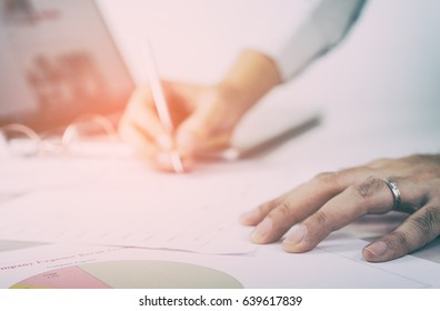 Business man is signing document on office table in vintage tone