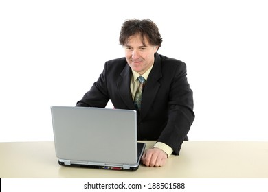 Business man sitting in front of his computer and working