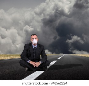 business man sitting in a middle of the road