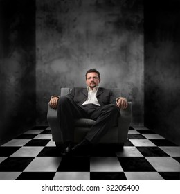 business man sitting on armchair alone in a room