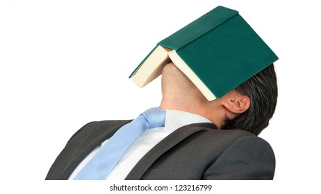 Business man is sleeping after reading a book