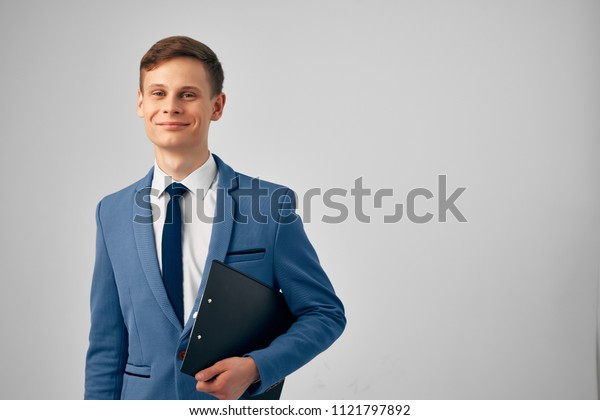 business man smiling holding documents