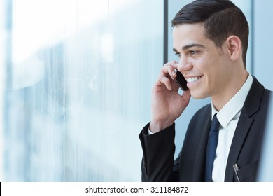 Business man speaking on mobile phone