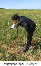 A business man speaking to the plants with a megaphone