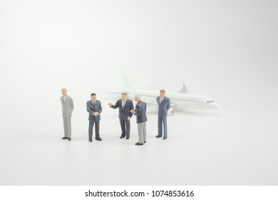 the business man stand before the plane
