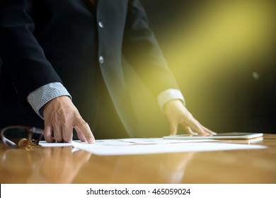 business man stand at the head of the table in boardroom black background