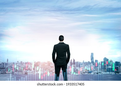 business man stand up and night city background