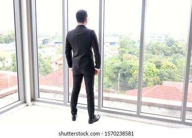 Business man standing back in the office