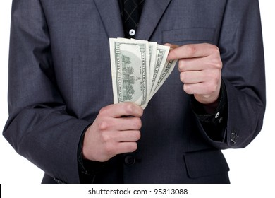 Business man standing and counting some american dollars in his hands, close up