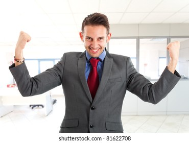 Business man standing with fists clenched in sign of victory