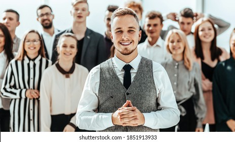 business man standing in front of a group of diverse young peop