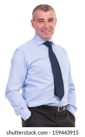business man standing with his hands in his pockets and smiling for the camera. on a white background