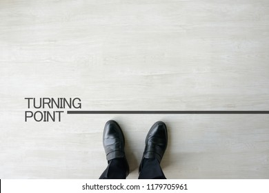 Business man standing on turning point