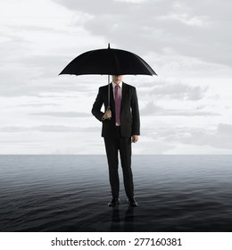 Business man standing on the water. Survive business crisis concept
