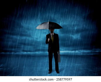 Business man standing in rain with an umbrella concept on background