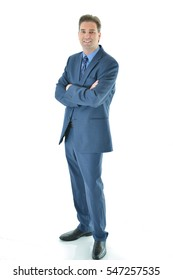 Business man standing with a smile (full vertical aspect)