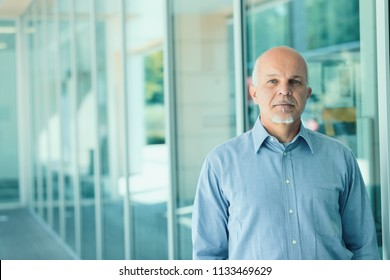 Business man standing while facing the camera.
