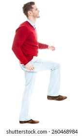 Business man stepping up for success - isolated over a white background