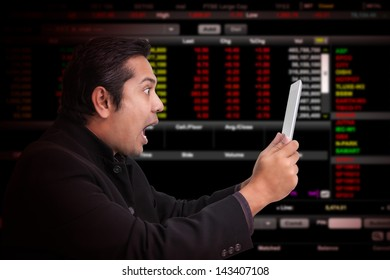 Business man with stock graph report