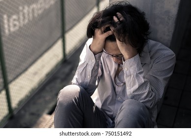 business man is stressed from his work. depression and anxiety concept.