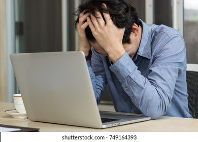 Business man are stressed sitting at office desk in office
