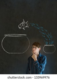 Business man, student or teacher with fish jumping from small bowl to big bowl on blackboard background