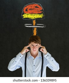 Business man, student or teacher with thought thinking chalk nuclear bomb cloud on blackboard background