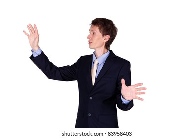 Business man in studio imitating touching a wall