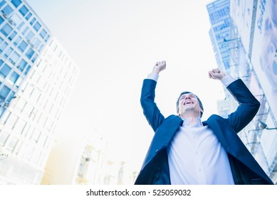 Business man success. Businessman winner. Happy win. Triumph, victory of successful people, person or executive manager in suit. Concept of career. Adult young male, guy smile.