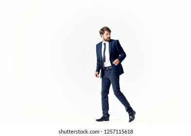 Business man in a suit on a light background in full growth