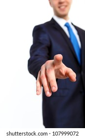 Business man in suit pushing a button with his finger
