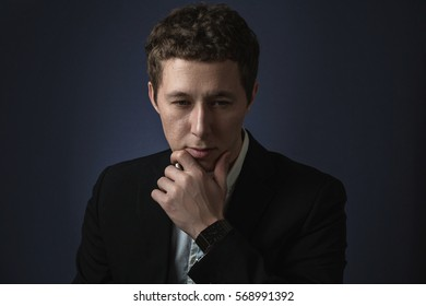 business man in suit standing brooding